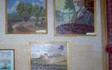 """Muziejuje saugomi A.Žmuidzinavičiaus mokinio Juozo Talandžio paveikslai ir mokytojos A.Čebatoriūtės A.Žmuidzinavičiaus paveikslo """"Dzūkų kaimelis"""" kopija."""